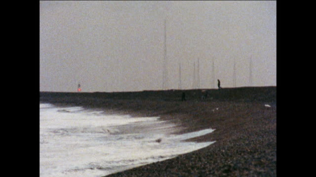 montage waves strike the english shore as lighthouses blink in the background / united kingdom - peter greenaway stock videos & royalty-free footage