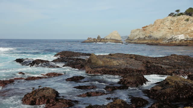 Waves tumble over Point Lobos State Natural Reserve California