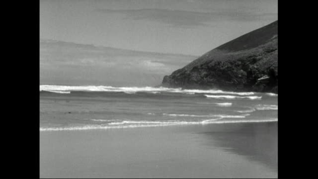 waves wash onto a sandy beach in cornwall;1951 - 1951 stock videos & royalty-free footage