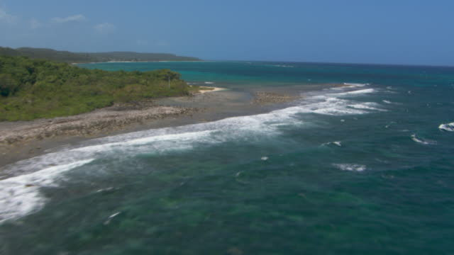 Waves wash up on the remote coastline in Jamaica.