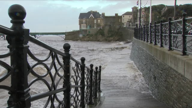waves washing against sea wall in a storm - weston super mare stock videos and b-roll footage