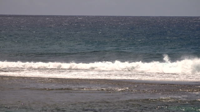 waves washing onto beach on kauai island - butte rocky outcrop stock videos & royalty-free footage