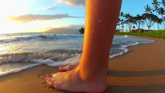 waves washing over young girls feet at the beach - one girl only stock videos & royalty-free footage