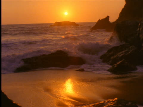 waves washing up on deserted beach at sunset / pacific ocean, california - 2001 stock videos and b-roll footage