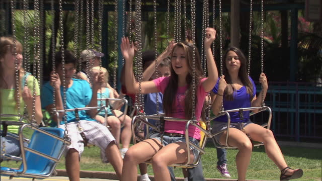 waveswinger ride at knott's berry farm theme park, zoom wide from teen group as ride begins - teenagers only stock videos & royalty-free footage