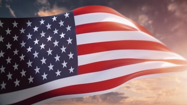 waving flag of usa against sunset clouds - patriotism stock videos & royalty-free footage