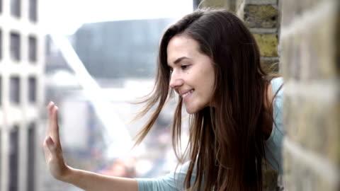 stockvideo's en b-roll-footage met zwaaien vanuit venster - waving