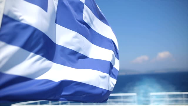 waving greek flag - tourboat stock videos & royalty-free footage