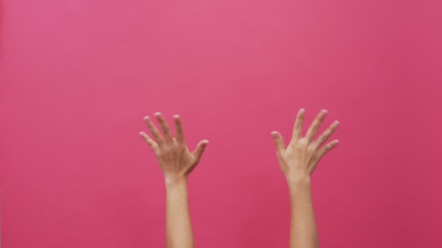 waving hands on isolated pink background 4k - hand stock videos & royalty-free footage