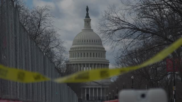 """vídeos de stock, filmes e b-roll de waving in the wind yellow barricade tape cautions """"do not enter"""" as the u.s. capitol is surrounded by fence on january 17, 2021 in washington, dc.... - cerca"""