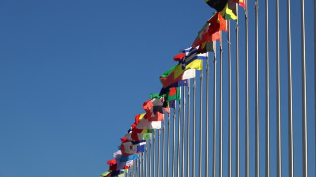 waving national flags - united nations building stock videos and b-roll footage