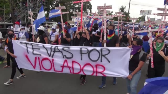 waving nicaragua flags thousands of opposition activists march in managua to demand the departure of president daniel ortega as part of three days of... - managua stock videos & royalty-free footage
