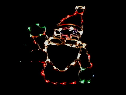 waving santa light decoration - weihnachtsmütze stock-videos und b-roll-filmmaterial