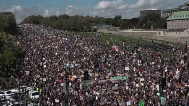 waving signs, cheering and chanting half a million people according to organizers demonstrate in montreal in the second in a global series of... - climate stock videos & royalty-free footage