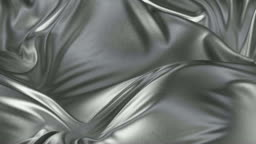 Waving silver satin fabric fluttering in the wind