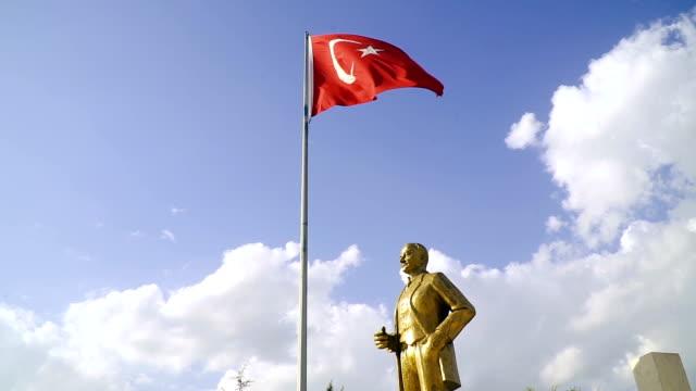 waving turkish flag with ataturk statue - ankara stock videos and b-roll footage