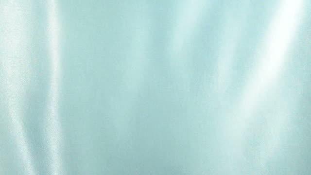 Waving turquoise satin