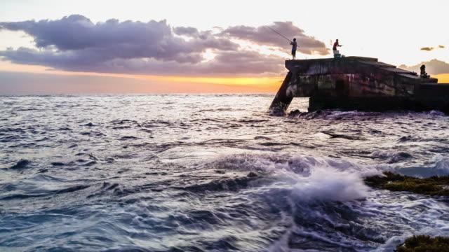 wawaloli beach park sunset fisherman - fiji stock videos & royalty-free footage