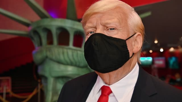 wax figure of u.s. president donald j. trump wearing a protective mask on display in the lobby as madame tussaud's new york re-opens to the public... - madame tussauds stock videos & royalty-free footage