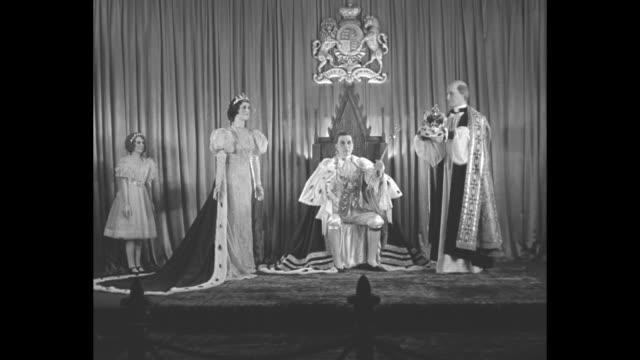 wax figures in coronation tableau, with rear shot spectators stopping to look / montage individual wax figures in tableau - queen elizabeth,... - archbishop of canterbury stock videos & royalty-free footage