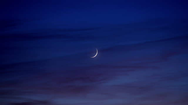 waxing crescent moon at dusk - astronomy stock videos & royalty-free footage
