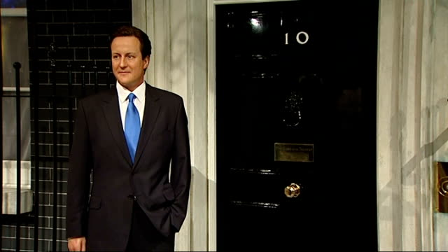 vídeos de stock, filmes e b-roll de waxwork of david cameron unveiled at madame tussauds close shot of 'downing street' sign on wall pan to david cameron waxwork / close shot of 'number... - visão geral