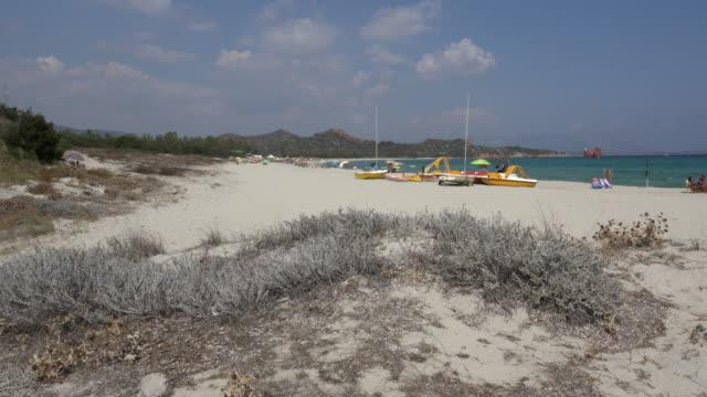 pan / way to lido di cea beach - spiaggia stock videos & royalty-free footage