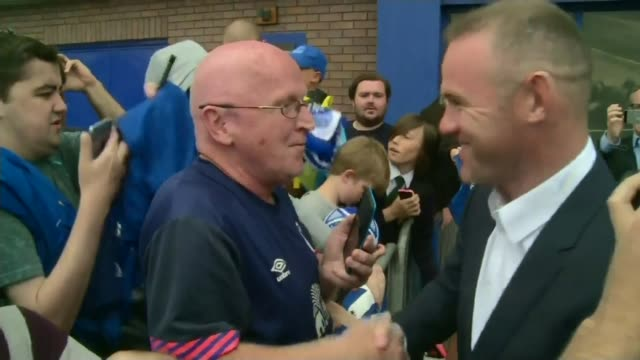 wayne rooney accused of drink driving t10071722 / 1072017 goodison park rooney holding up everton shirt for photocall after rejoinging the club from... - babygro stock videos & royalty-free footage