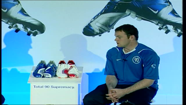 wayne rooney injury world cup prospects file / r25040613 rooney at press conference to launch new nike football boot the total supremacy 90 boots on... - nike designer label stock videos and b-roll footage