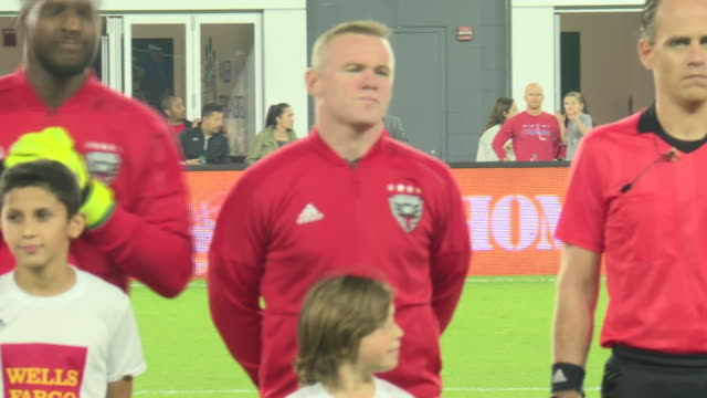 wayne rooney lines up ahead of dc united's play off game against columbus crew stands for usa national anthem and poses for team photo - major league soccer stock videos and b-roll footage
