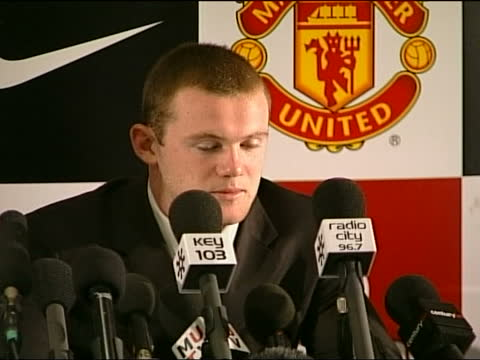 wayne rooney press conference upon signing for manchester united; england: manchester: int ** flash photography ** from left to right: sir alex... - lighting technique stock videos & royalty-free footage