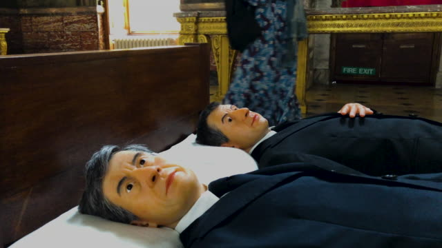 """we"""", a double self-portrait of the artist maurizio cattelan in bed, created by artist maurizio cattelan, is seen at blenheim palace on september 12,... - double bed stock videos & royalty-free footage"""