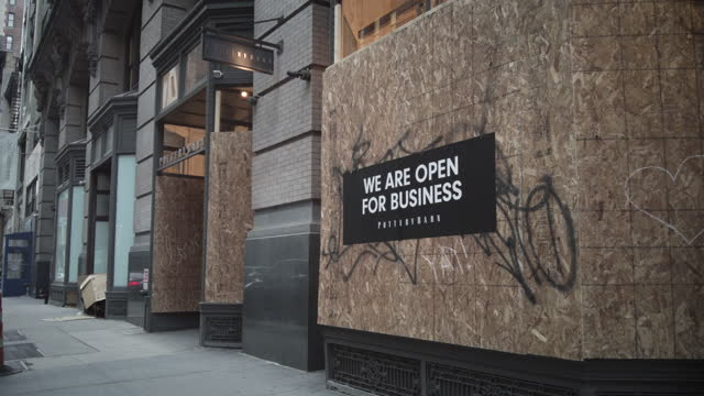 """""""we are open for business"""" sign on boarded up store in manhattan's midtown new york city. filmed during the 2nd wave of the coronavirus pandemic in... - opening stock videos & royalty-free footage"""