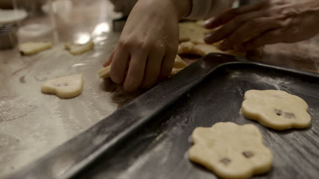 we can't wait to get these in the oven - baking tray stock videos & royalty-free footage