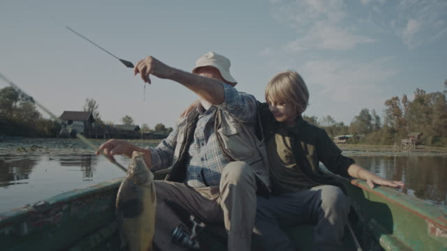 we catch the fish! - grandparents stock videos & royalty-free footage