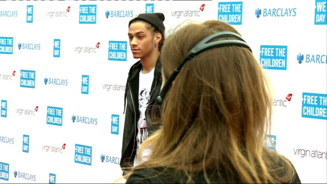 vídeos de stock e filmes b-roll de we day uk 2014 event held at wembley arena red carpet arrivals and interviews england london wembley arena throughout ** close shot 'free the... - wembley arena