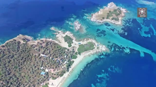 we fly above the absolute exotic paradise of halkidiki, a place endowed with so much beauty that crosses the borders of greece and is reminiscent of... - bahamas stock videos & royalty-free footage