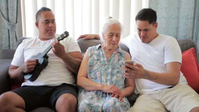 we love our grandmother - pacific islander male stock videos & royalty-free footage