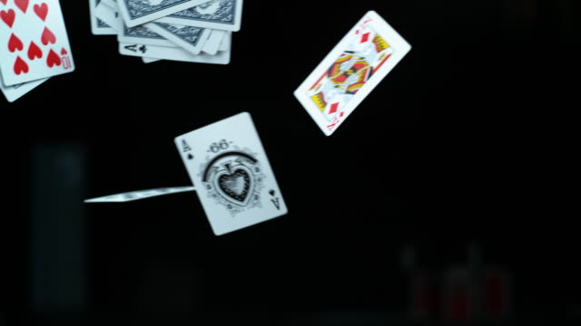 vídeos de stock e filmes b-roll de we play the cards we're dealt - carta de baralho