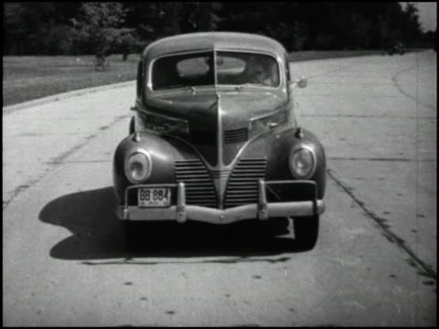 / we see a montage of 1939 cars while the narrator says that these cars are disappointing because they all look alike cars include dodge lincoln... - look alike stock videos and b-roll footage