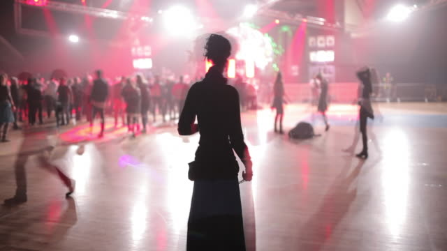 stockvideo's en b-roll-footage met we see people playing with light artiffacts and we see venue lights in the background the effect is a streak on camera to see the lights in continue... - pardo