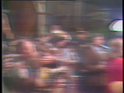 """we see the hollywood premiere for the film """"9 to 5."""" people are gathered under a tent with a car on the street next to them. a klieg light is shown... - music or celebrities or fashion or film industry or film premiere or youth culture or novelty item or vacations点の映像素材/bロール"""