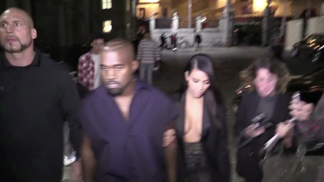 we spotted kim kardashian in yet another outfit this time showing an amazing cleavage and her husband kanye west arriving at the lanvin fashion show... - dekolleté stock-videos und b-roll-filmmaterial