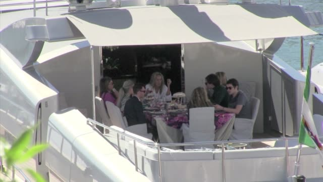 we spotted the american actress sharon stone having lunch with some friends on roberto cavalli's yacht during the 2013 cannes film festival cannes... - roberto cavalli stock videos and b-roll footage