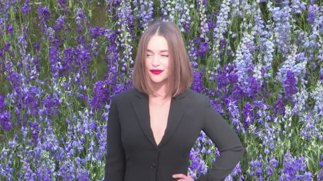 we spotted the beautiful game of thrones star emilia clarke posing for the photographers in her little black dress while attending the dior spring... - black dress stock videos & royalty-free footage