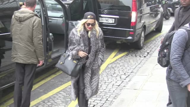 we spotted the british singer and songwriter rita ora arriving at the sers hotel in paris. she is expected tonight at the vip room and at skyrock... - songwriter stock videos & royalty-free footage