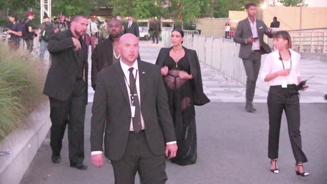 we spotted the hip hop superstar kanye west and his wife the very pregnant kim kardashian arriving at the givenchy spring summer 2016 fashion show in... - spring summer collection stock videos & royalty-free footage