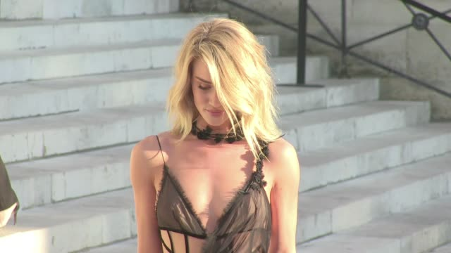 we spotted the model turned actress rosie huntington whiteley attending the versace haute couture fashion show in paris on july 05, 2015 in paris,... - ファッションコレクション点の映像素材/bロール