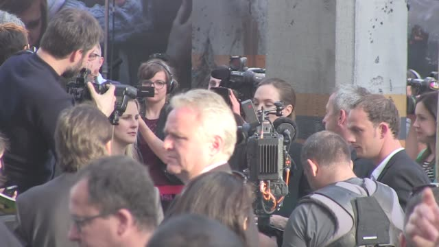 We spotted the oscar winning actress Angelina Jolie on the red carpet of Brad Pitt's latest flick World War Z in Paris France A massive crowd of fans...