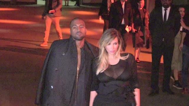 we spotted the reality tv star kim kardashian and kanye west arriving at the givenchy fashion show during paris fashion week kardashian shows off her... - 2013 bildbanksvideor och videomaterial från bakom kulisserna